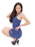 Young beautiful woman in blue pleated sun-dress. Studio portrait on white Stock Images