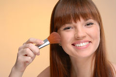 Young beautiful woman blushing with brush Royalty Free Stock Photos