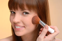 Young beautiful woman blushing with brush Stock Photography