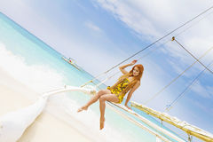 Young beautiful woman on board of sea yacht Royalty Free Stock Images