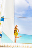Young beautiful woman on board of sea yacht Royalty Free Stock Image