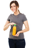 Young beautiful woman with bottle of juice Stock Photos