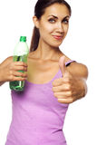 Young beautiful woman with bottle of water Stock Photos
