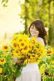 Young beautiful woman with a bouquet Royalty Free Stock Photo