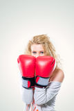 Young beautiful woman in Boxing gloves Stock Photos