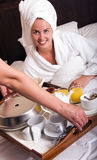 Young beautiful woman with breakfast in bed Royalty Free Stock Photography
