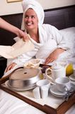 Young beautiful woman with breakfast in bed Stock Image