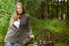 Young beautiful woman on the brige Royalty Free Stock Photos