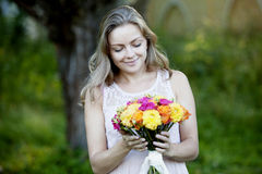 Young beautiful woman with a bright bouquet of Royalty Free Stock Photo