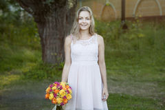 Young beautiful woman with a bright bouquet of Stock Images