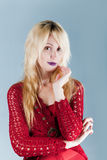The young beautiful woman in brightly red blouse.Portrait Royalty Free Stock Photos