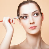 young beautiful woman with brush for make-u Stock Photography