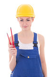 Young beautiful woman builder in blue coveralls with screwdriver Stock Image
