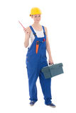 Young beautiful woman builder in workwear with toolbox and screw Royalty Free Stock Photos