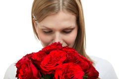Young beautiful woman with a bunch of roses Stock Images