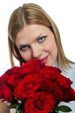 Young beautiful woman with a bunch of roses Stock Image