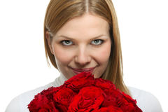 Young beautiful woman with a bunch of roses Royalty Free Stock Images