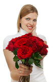 Young beautiful woman with a bunch of roses royalty free stock photography