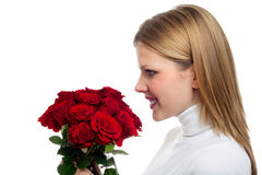 Young beautiful woman with a bunch of roses Stock Photo