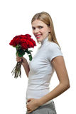 Young beautiful woman with a bunch of roses Stock Photos