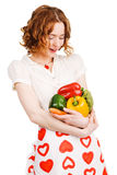 Young beautiful woman with a bunch of vegatables Stock Image