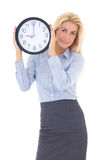 Young beautiful woman in business suit holding office clock Stock Photography