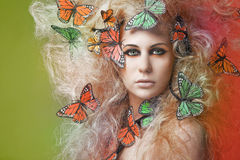 Young beautiful woman with butterfly. Royalty Free Stock Photos