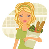 Young beautiful woman buying healthy food Royalty Free Stock Image
