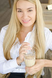 A young beautiful woman in cafe Stock Image