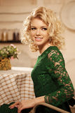 Young beautiful woman in a cafe. Modern trendy blondy girl in re Royalty Free Stock Images