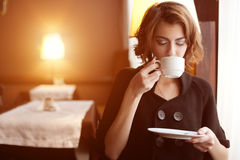 Young beautiful woman in a cafe. Modern trendy blondy girl in re. Young beautiful woman in a cafe. Modern trendy blondy girl in the restaurant Stock Image