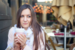Young beautiful woman in cafe Royalty Free Stock Images
