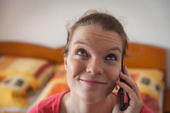 Young beautiful woman calling from a mobile phone Royalty Free Stock Photography