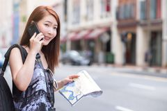 Young beautiful woman calling public taxi by phone royalty free stock images