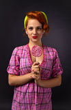 Young beautiful woman with candy Stock Images