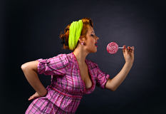 Young beautiful woman with candy Stock Photos