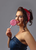 Young beautiful woman with candy Stock Photo