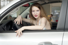 Young beautiful woman in the car. Young beautiful woman in white car Royalty Free Stock Images