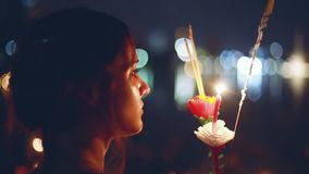 Young beautiful woman in a carnival to celebrate the Loy Krathong Festival. 1920x1080. Hd stock video footage