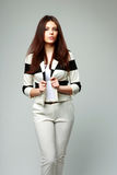 Young beautiful woman in casual clothes. On gray background Royalty Free Stock Images