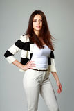 Young beautiful woman in casual clothes. On gray background Royalty Free Stock Image