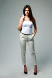 Young beautiful woman in casual clothes standing. On gray background Stock Image