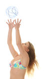 Young beautiful woman catching a beach ball Stock Photos