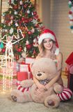 Beautiful woman celebrates Christmas at home in the interior wit royalty free stock photos