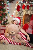 Beautiful woman celebrates Christmas at home in the interior wit stock photos