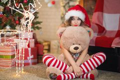 Beautiful woman celebrates Christmas at home in the interior wit royalty free stock photo