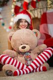Beautiful woman celebrates Christmas at home in the interior wit royalty free stock image