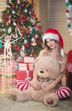 Beautiful woman celebrates Christmas at home in the interior wit stock images