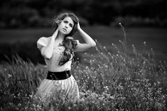 Young beautiful woman on cereal field with poppies in summer - b Royalty Free Stock Photos