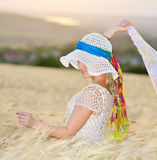 Young beautiful woman on cereal field in summer Royalty Free Stock Photography